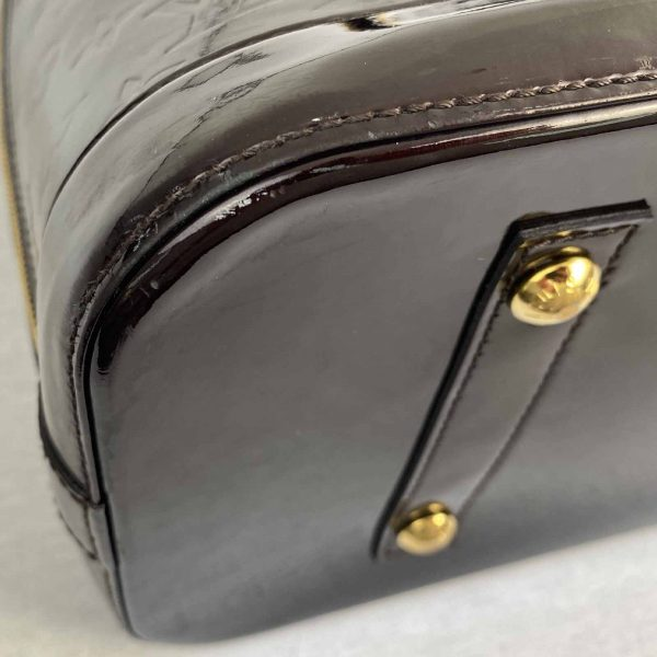 Louis Vuitton Alma GM Large Amarante Vernis Leather bottom left corner