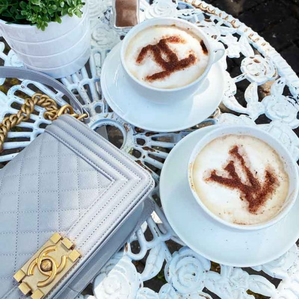 Louis Vuitton and Chanel Logo Coffee Stencils on table