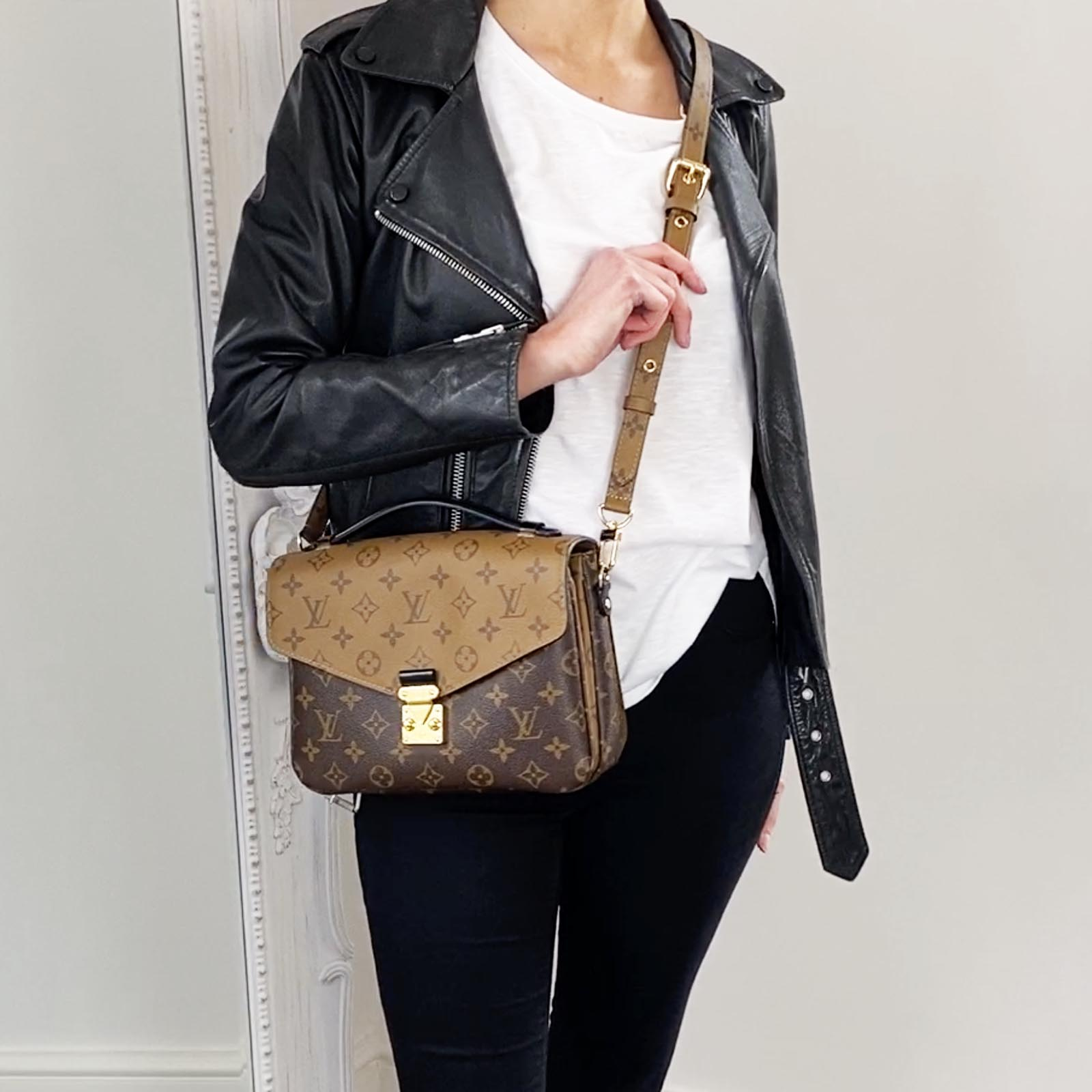 Louis-Vuitton-Pochette-Metis-reverse-monogram-bag-styled-with-leather-jacket-and-jeans
