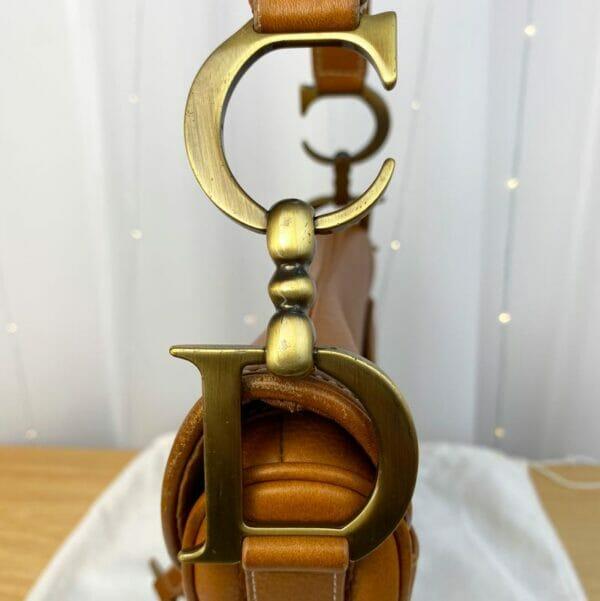 Dior Saddle Bag Tan Camel Gold Hardware on person model C D Logo