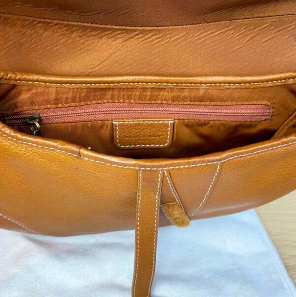 Dior Saddle Bag Tan Camel Gold Hardware on person model Inside bag