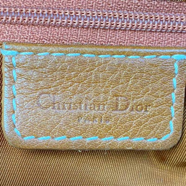 Dior Saddle Bag Tan Camel Gold Hardware on person model Tag inside