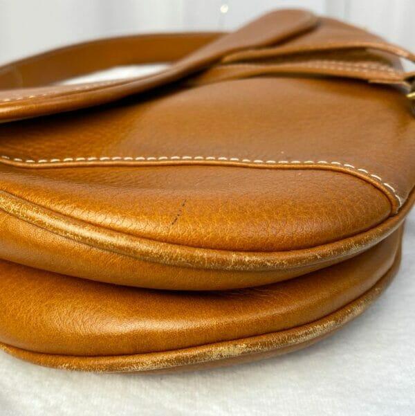 Dior Saddle Bag Tan Camel Gold Hardware on person model corners 2