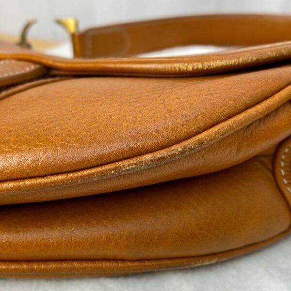 Dior Saddle Bag Tan Camel Gold Hardware on person model corners