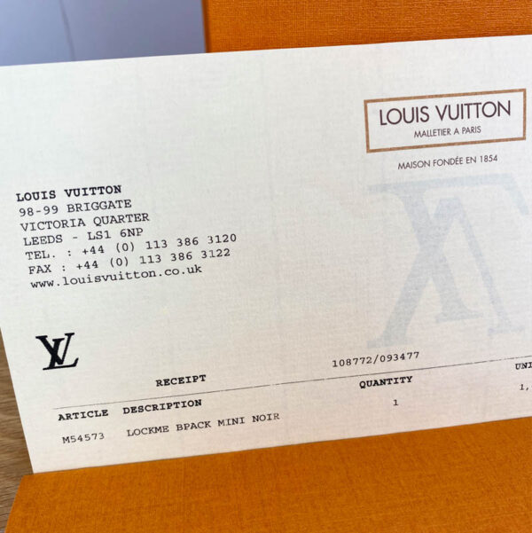 Louis Vuitton LockMe Mini Backpack Black and Gold receipt