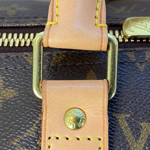 Louis Vuitton monogram keepall 50 vachetta leather buckle detail
