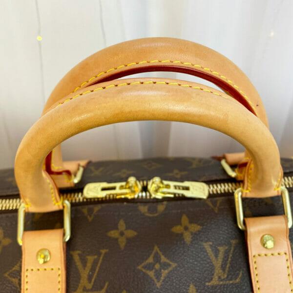 Louis Vuitton monogram keepall 50 vachetta leather handles close