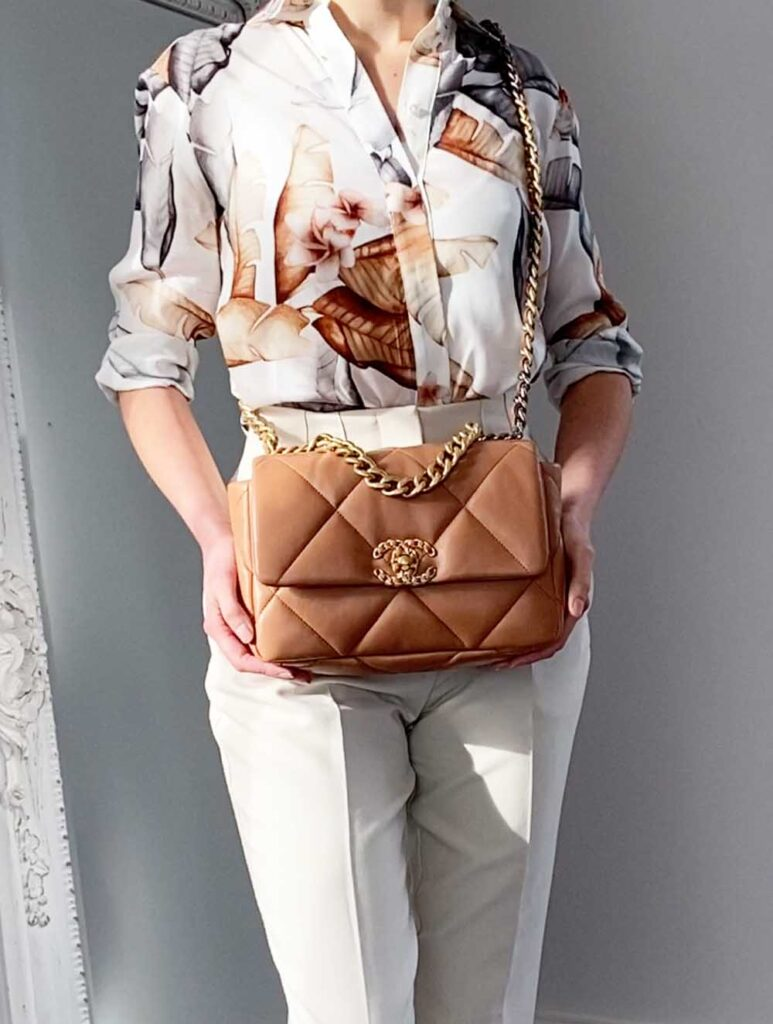 Chanel 19 small caramel bag worn crossbody with summer outfit