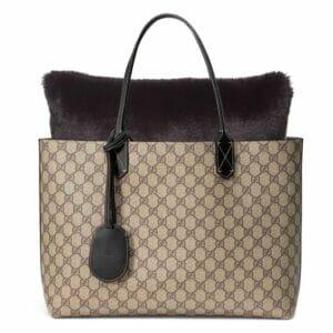 Large black faux fur bag purse pillow in gucci tote bag