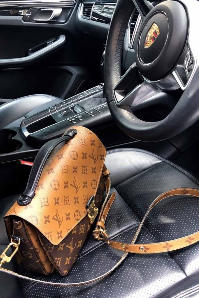 Louis Vuitton Reverse Monogram Pochette Metis bag in porcshe car