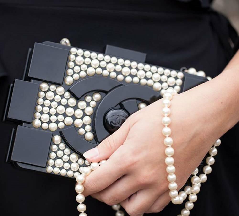14. Chanel Pearl Lego Clutch holding